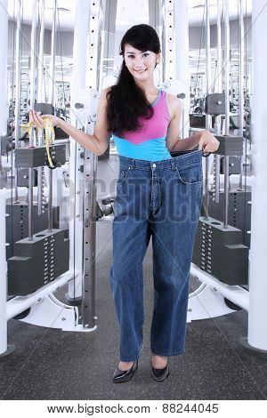 Woman With Old Jeans At Gym Center