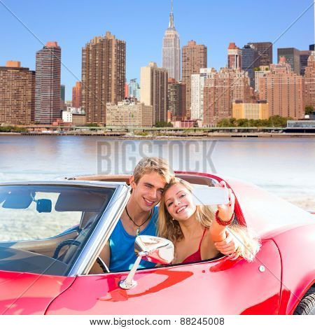 selfie of young teen couple at convertible car in New York Manhattan skyline photo mount
