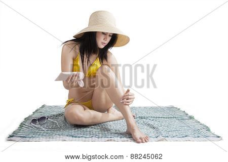 Young Woman Using Sunblock