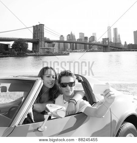 selfie of young teen couple at convertible car in New York Brooklyn Bridge photo mount