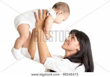 portrait of joyful new mother holding small baby boy