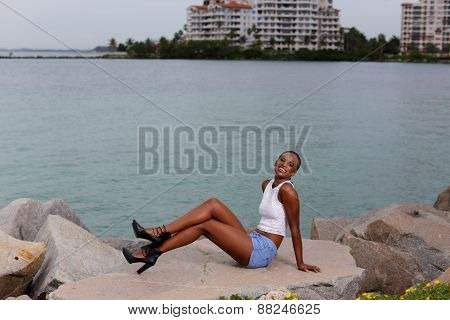 Woman posing by the rocks