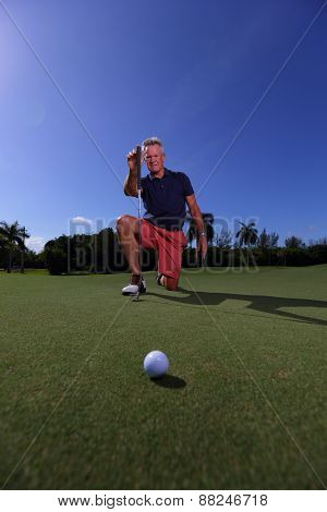 Handsome senior golfer