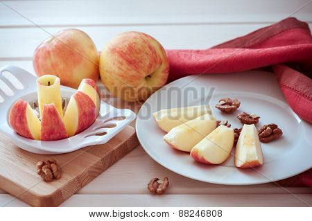 apple is sliced into wedges.