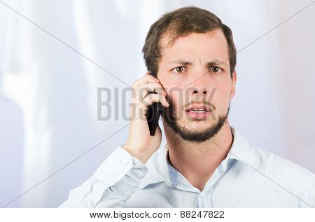 young handsome man using cell phone