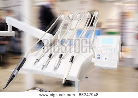 The image of dental tools on the rest under the white background