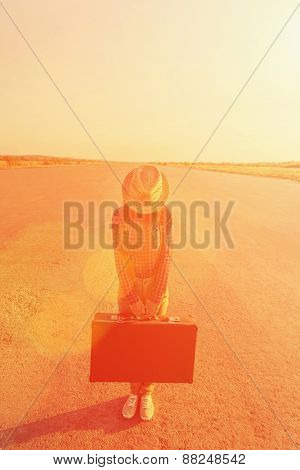 Traveler woman with suitcase