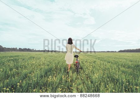 Girl Walking With Bicycle In Summer