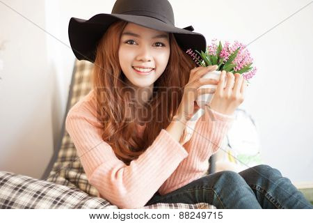 Long Haired Asia Girl Happy Smile With Little Flowers