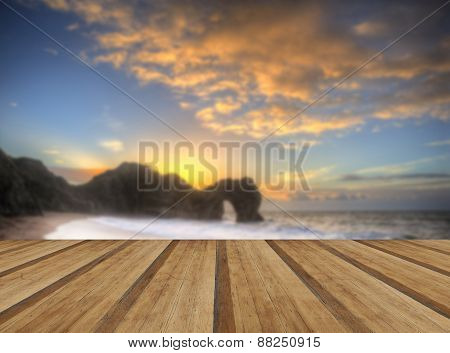 Vibrant Sunrise Over Ocean With Rock Stack In Foreground With Wooden Planks Floor