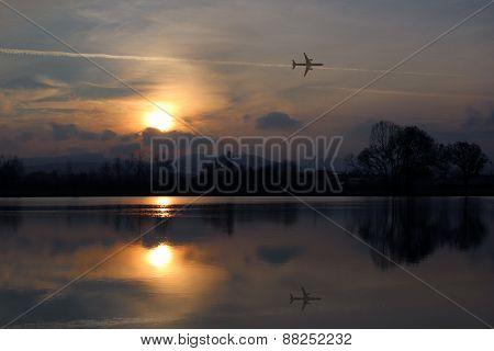 Lake Sunrise With Airplane Reflection