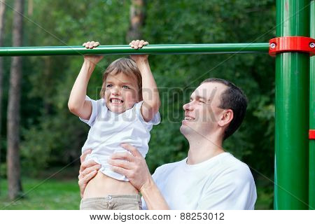 Father And Son Play Sports