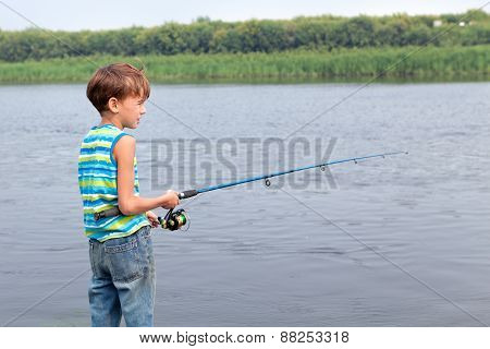 Boy Fishing On River, Summer