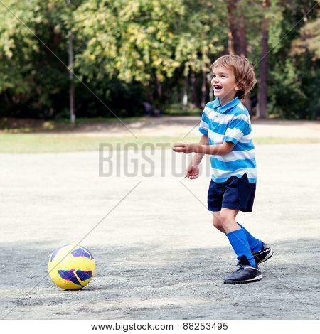 Happy Boy Playing Football