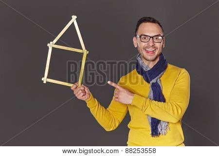 Man showing house frame concept