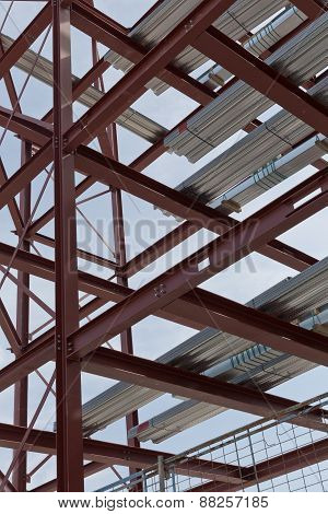 A detailed view of red steel structure and standard metal profiled decking