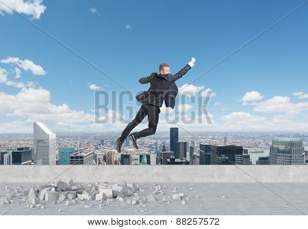 Businessman Is Flying Up From The Roof In New York. A Concept Of The Success In Career.