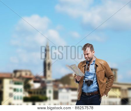 Handsome Tourist Man Is Examining The Map. Florence On The Background