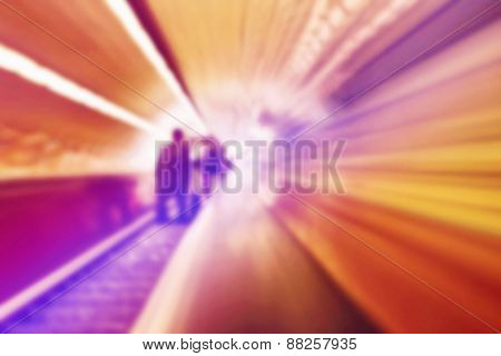 Blurred Abstract Background Of People On Oving Escalators