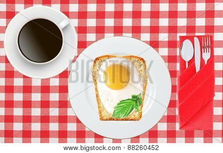 Scrambled Eggs With Bread On Plate On Color Napkin And Coffee Cup