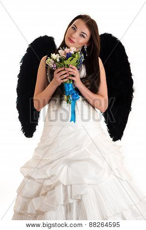 beautiful woman in a wedding dress with black wings