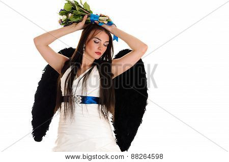 woman in a wedding dress with black wings