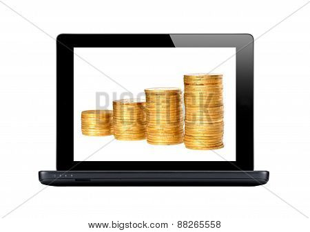 Black Laptop And Golden Coins On Screen Isolated On White