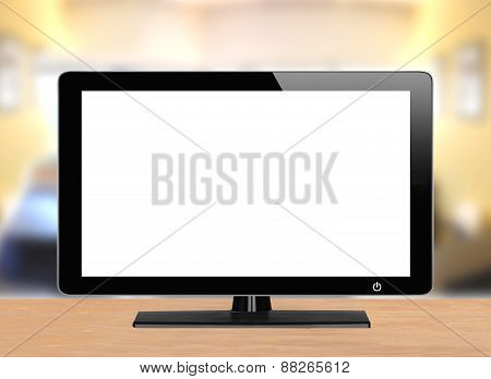 Computer Monitor On Wooden Table Over Bright Background