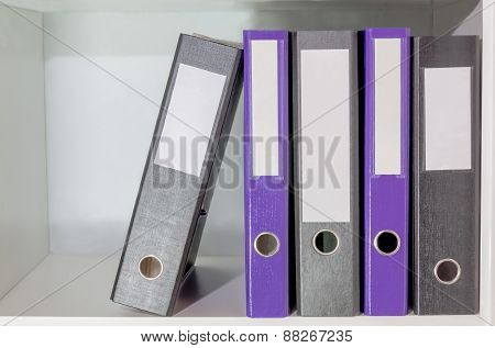 Folders For Documents On A Book Shelf