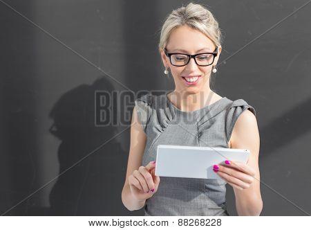 Teacher using tablet computer in classroom