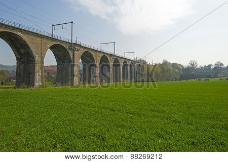 Railroad over a viaduct through a sunny countryside