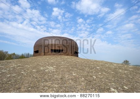 Belgian bunker from WW II under a blue cloudy sky