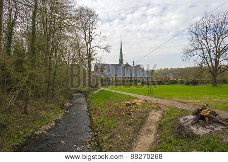 Abbey church under a cloudy sky in spring