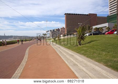 Unknown People Walking On Promenade In Durban