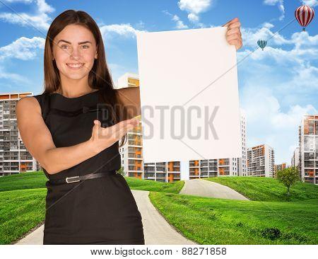 Estate agent holding blank poster