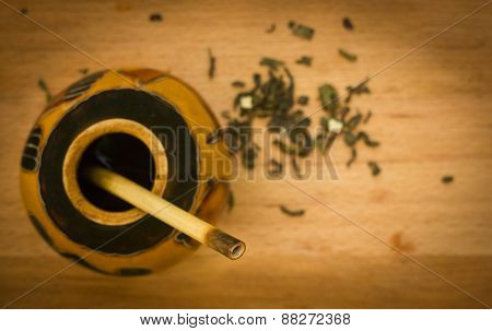 herbal tea mate in kalabas on wooden board, blured
