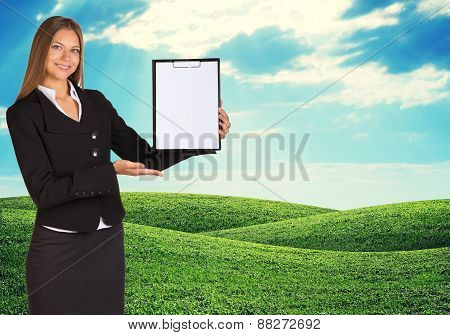 Young woman holding paper holder with nature on background