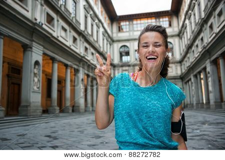 Happy Fitness Woman Showing Victory Gesture Near Uffizi Gallery