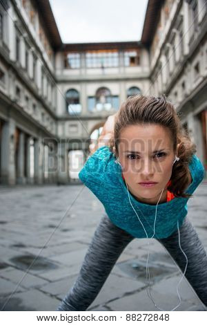 Fitness Woman Stretching Near Uffizi Gallery In Florence, Italy