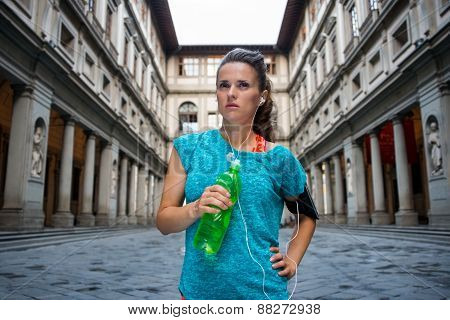 Fitness Woman With Bottle Of Water Near Uffizi Gallery In Florence, Italy