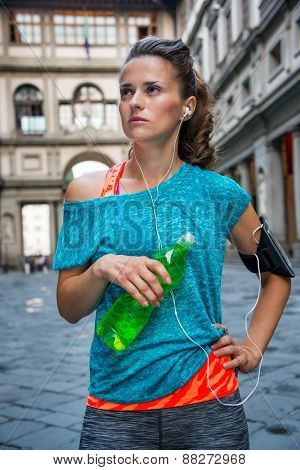 Fitness Woman With Bottle Of Water Near Uffizi Gallery In Floren