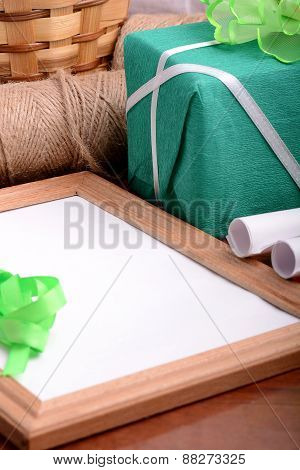 Green Gift Box And Wooden Board, Holiday Concept