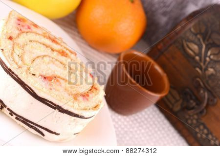 Sweet Cake On White Plate With Fruits
