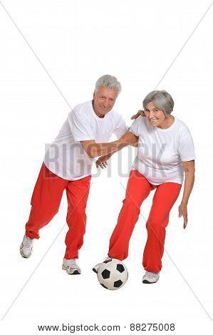 Senior couple with a ball