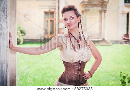 Beautiful Young Woman In Corset And Shirt