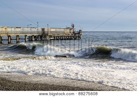 Sea Side Waves And Pier