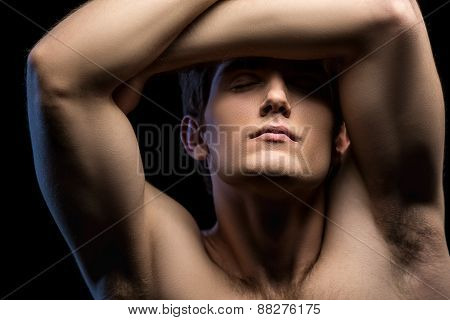 Close-up portrait of an attractive man with naked torso