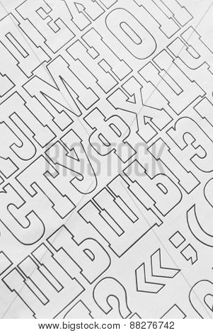cyrillic alphabet letters paper background. black and white background