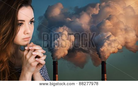 Praying Woman Against Of Pipes Polluting An Atmosphere