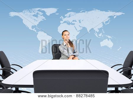 Business woman sitting at table